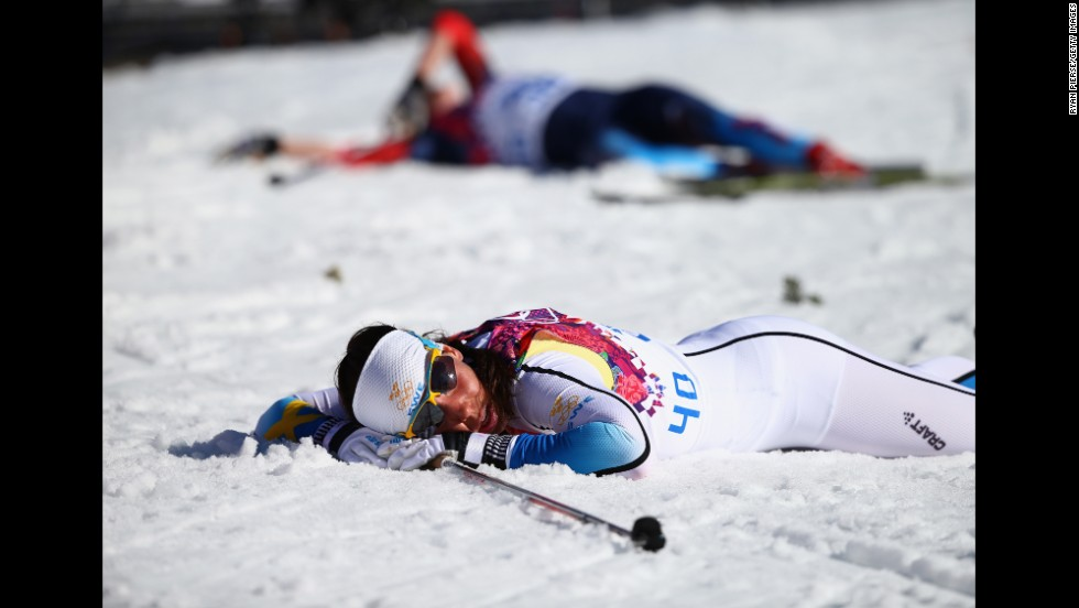 Cross-country skier Charlotte Kalla of Sweden reacts after crossing the finish line during the women's 10-kilometer classic on February 13.