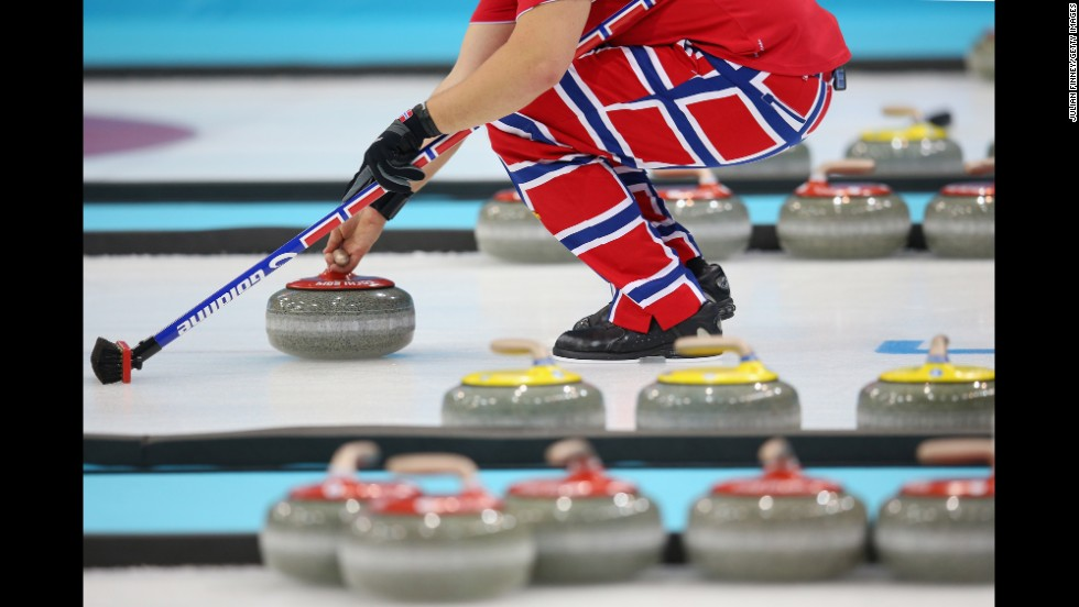 A Norwegian curler prepares for a throw during a curling match February 13.
