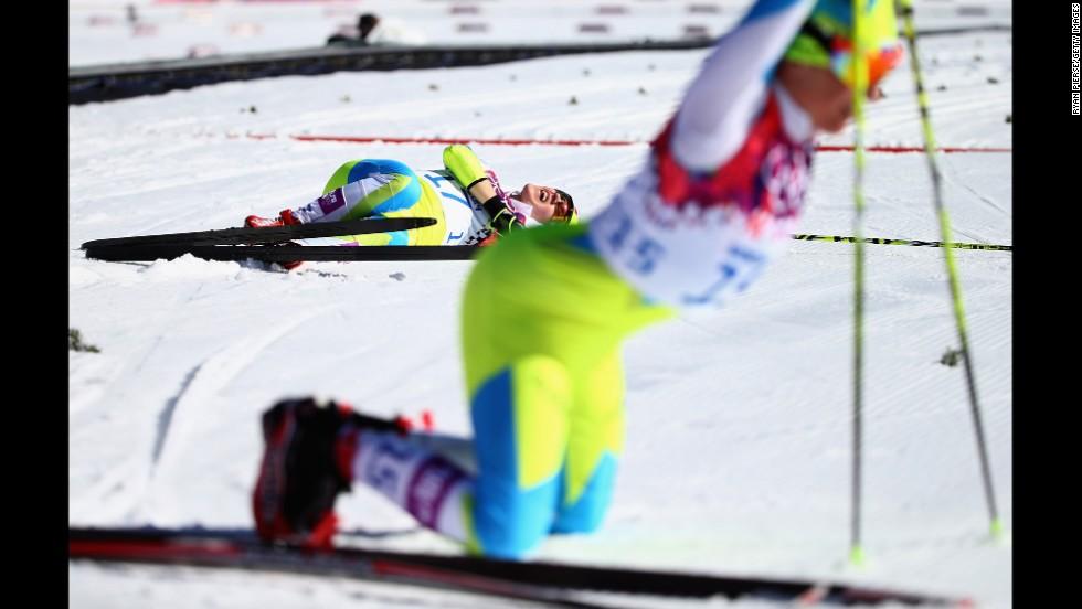 Cross-country skier Alenka Cebasek of Slovenia falls to the ground after the women's 10-kilometer classic.