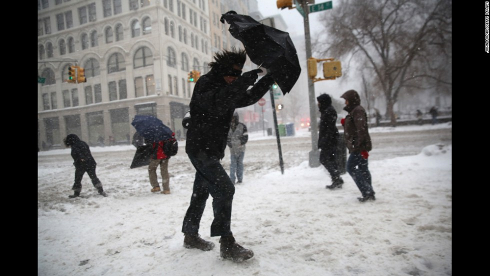 A man braces his umbrella while walking through the wind and snow in New York City on February 13.