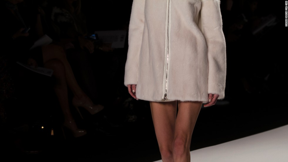 A bare-legged model rocked a cozy coat down the runway.