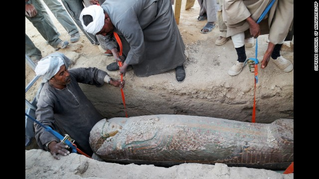 Men dig up the sarcophagus in Luxor. The sarcophagus belonged to a top government official, reports say.