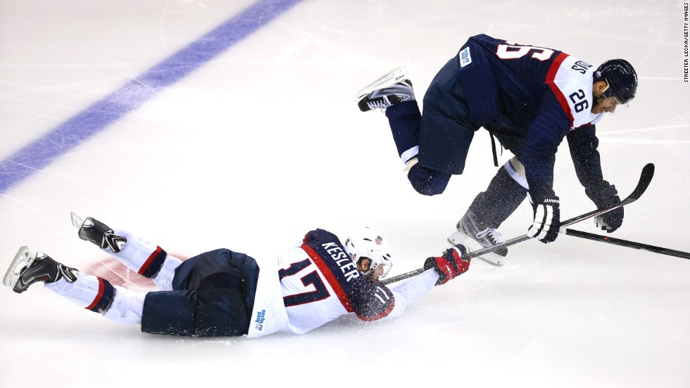 Ryan Kesler of the United States battles Slovakia's Michal Handzus for the puck during their men's hockey game on Thursday, February 13.