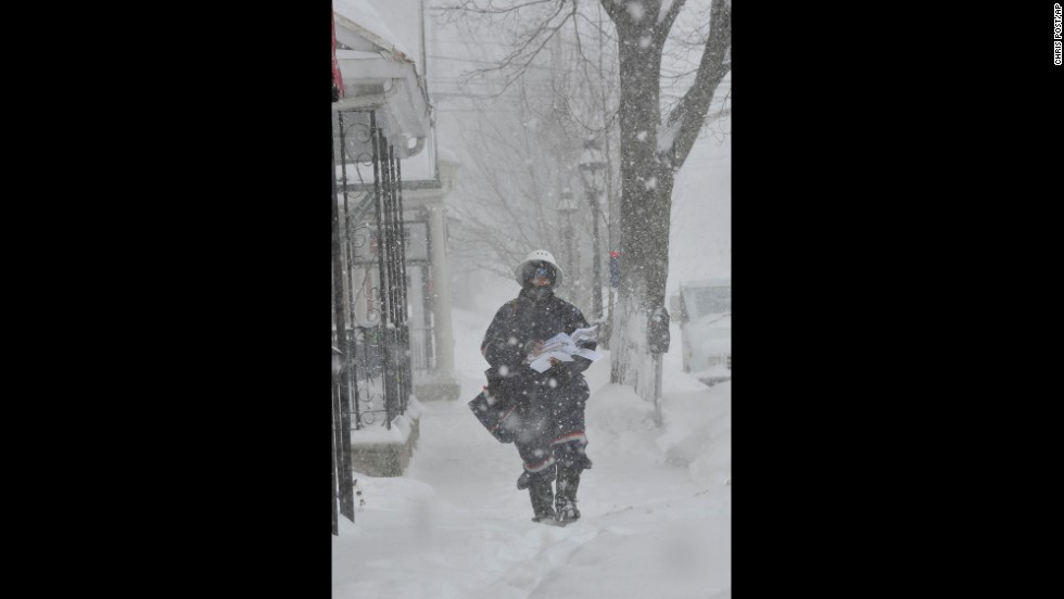 A postal worker makes his delivery rounds through blizzard conditions in Bethlehem, Pennsylvania, on February 13.