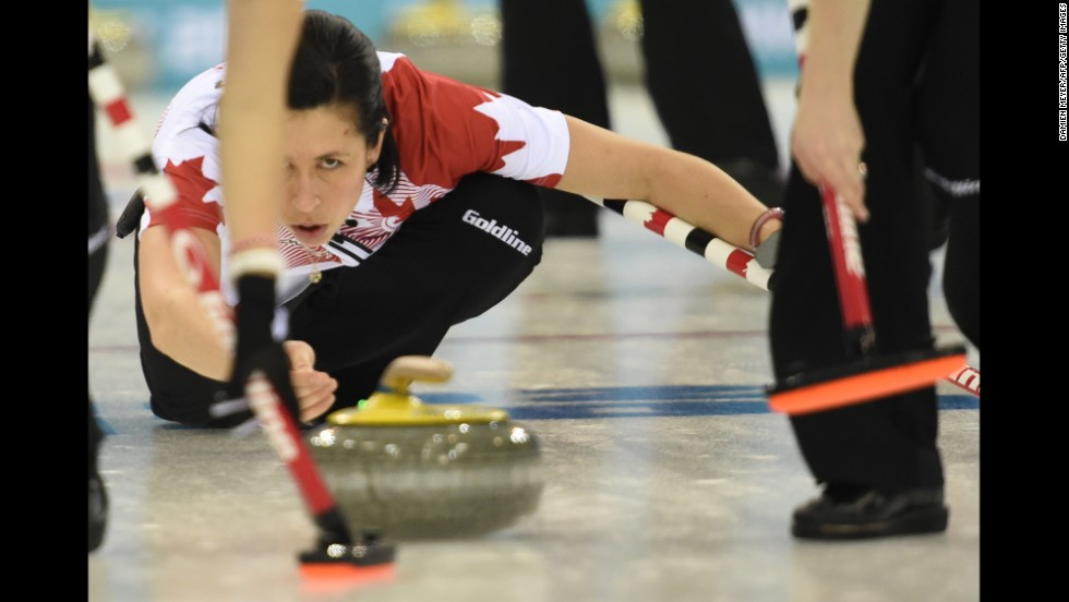 Canada's Jill Officer throws the stone during a women's curling match between Canada and Switzerland on February 13.