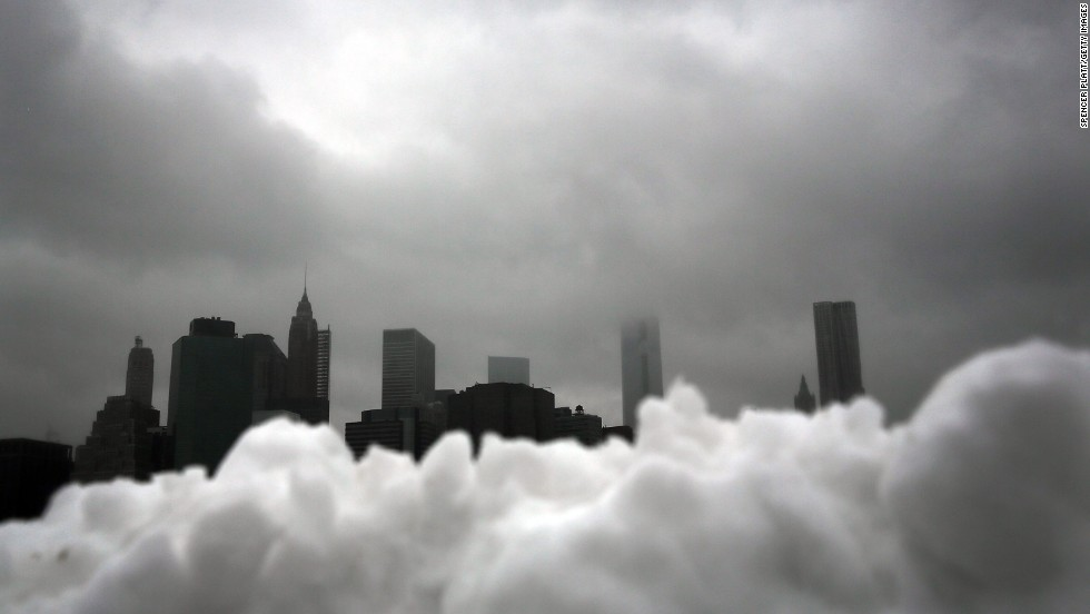 The lower Manhattan skyline is seen behind a pile of snow in Brooklyn on February 13.