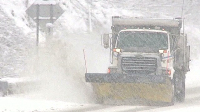 Snowstorm churns north along east coast