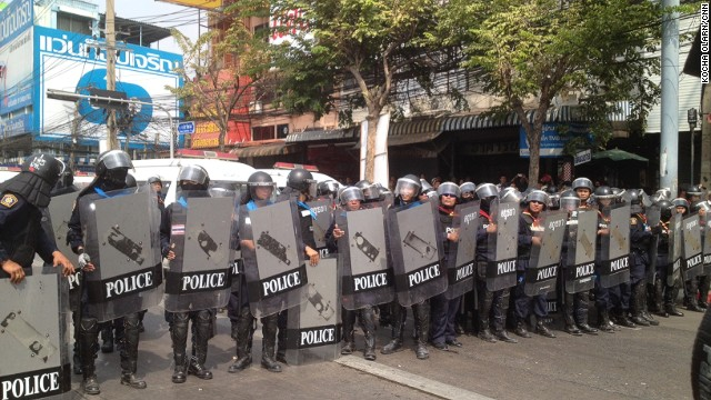 Thai security forces prepare for confrontation at a protest site near a government complex in Bangkok.