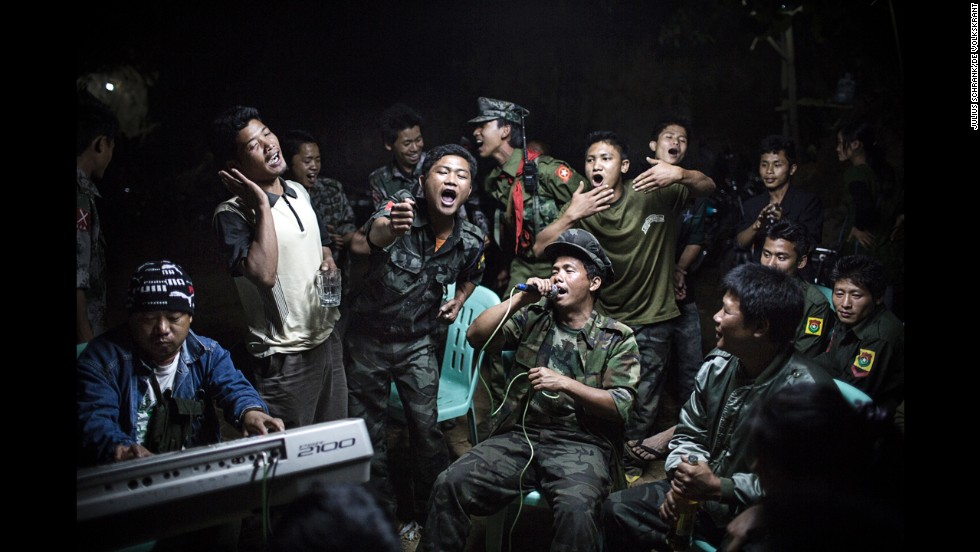 <strong>1st Prize Daily Life Single: </strong>Kachin Independence Army fighters celebrate at a funeral of one of their commanders who died the day before.