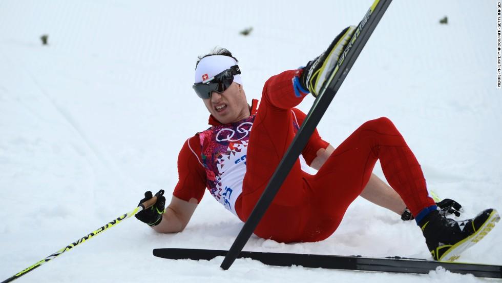 Switzerland's Dario Cologna crosses the finish line to win gold in the men's 15-kilometer classic on February 14.