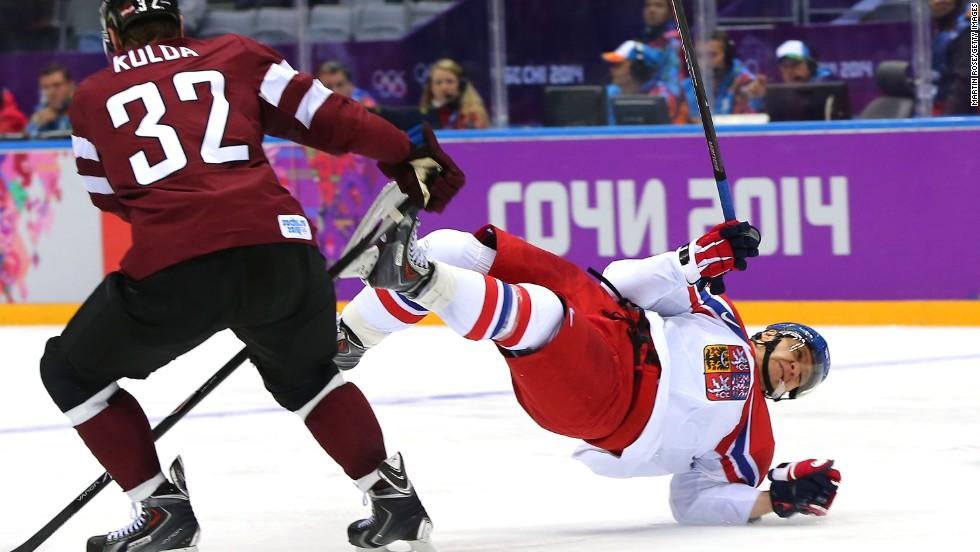 Hockey player Martin Erat of the Czech Republic falls to the ice February 14.