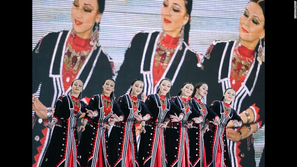 A traditional Russian dance is performed on stage during a medal ceremony February 12.