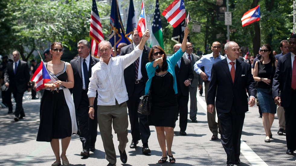 <strong>Do genuinely try to relate:</strong> Former  New York Mayor Michael Bloomberg, a Republican turned independent, could barely speak a lick of Spanish, but his oftentimes hilarious attempts endeared him to  the city's Spanish-speaking residents. He's shown here at the Puerto Rican Day Parade on June 10, 2012.
