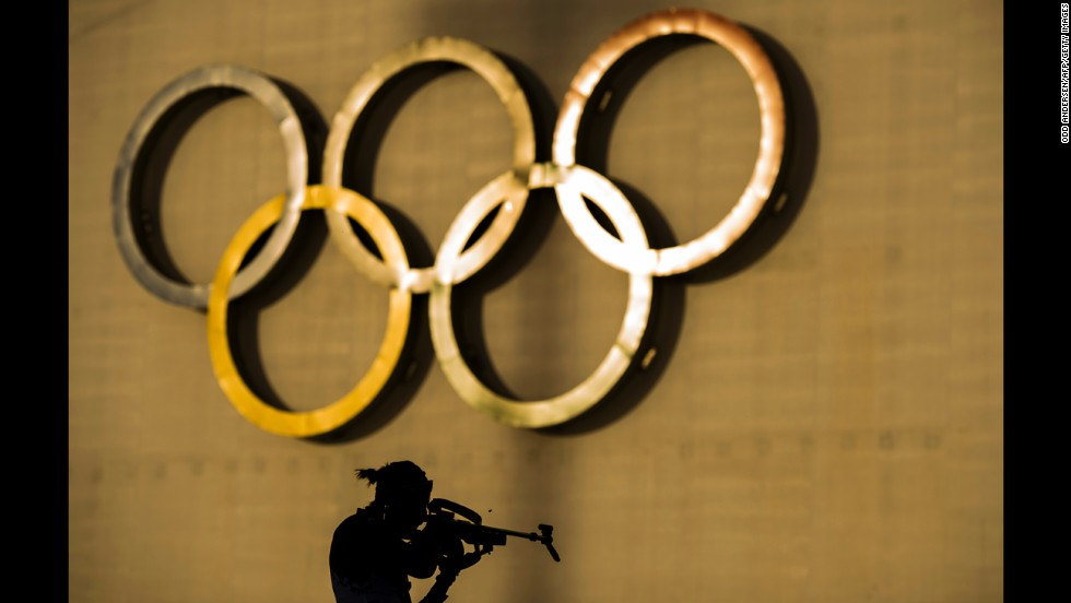 Russia's Olga Podchufarova shoots at the range February 14 during a warm-up for the women's 15-kilometer biathlon.