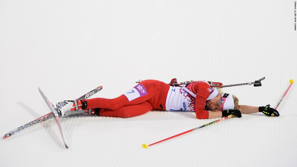 Cross-country skier Elisa Gasparin of Switzerland collapses at the finish line of the women's 15-kilometer race on February 14.