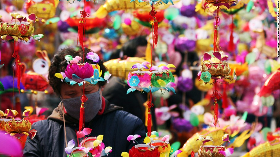 Locals stock up on lanterns at the market at Confucius Temple in Nanjing before the big day.