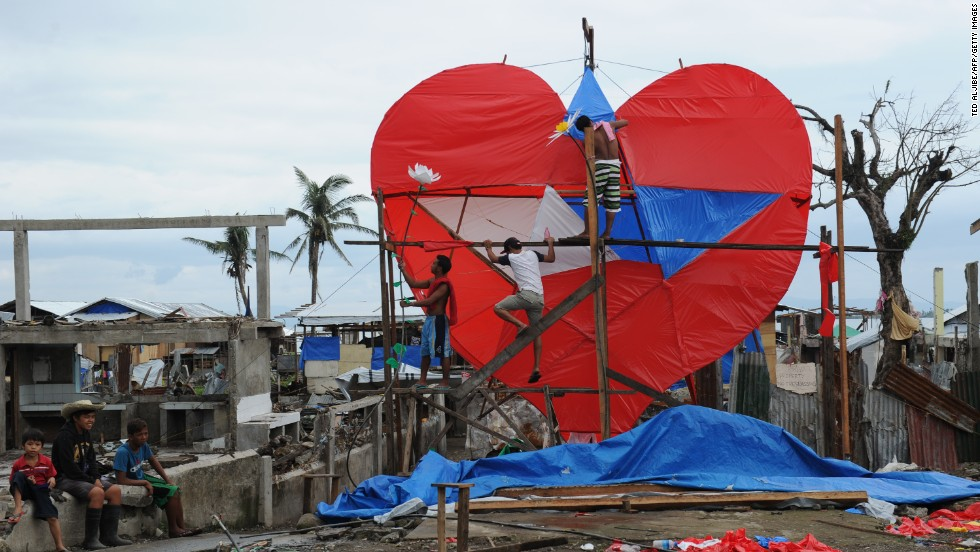 FEBRUARY 14 - TACLOBAN, PHILIPPINES: Residents and survivors of typhoon Haiyan put the finishing touches to a giant heart-shaped lantern displayed along the coastal area of Tacloban City, in central Philippines. Tacloban was among the worst hit places by the typhoon, which killed over 6,200 people.