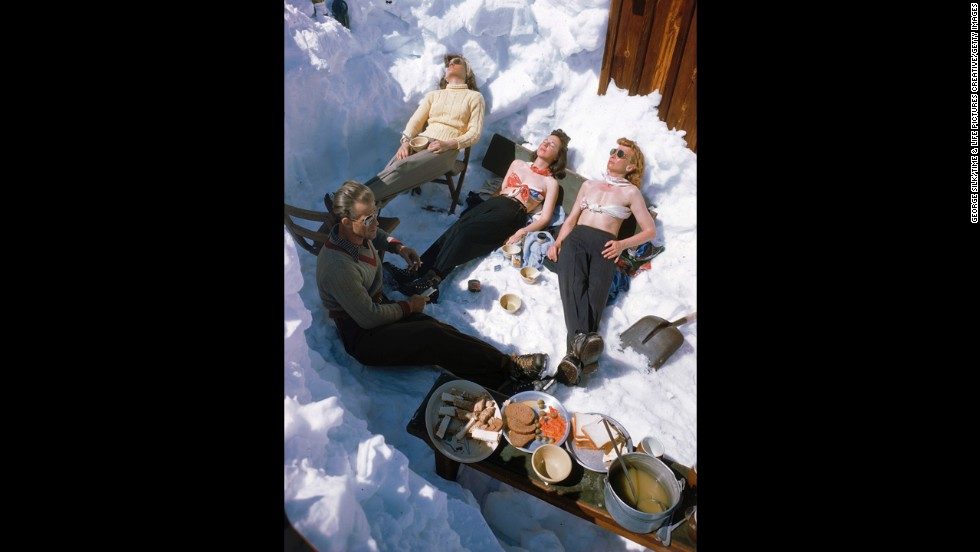 Spring skiers sunbathe in April 1947.