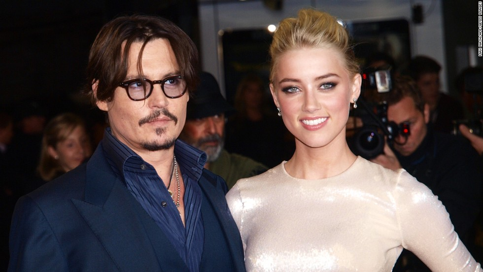 "Depp and his ex-partner Paradis confirmed their split in June 2012, and by the following spring the actor was photographed spending time with his ""Rum Diary"" co-star, Amber Heard. The couple kept their courtship largely under wraps, and even tried to hide their engagement at the beginning of 2014. By February, however, Depp and Heard were proudly attending the premiere of her film ""3 Days to Kill,"" and made no effort to hide either their affection or the sizable rock on Heard's left hand."