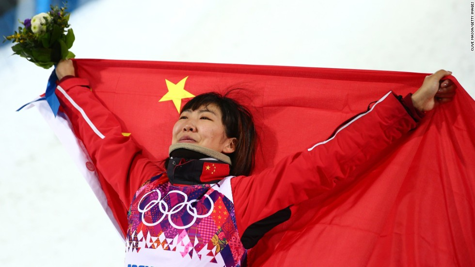 Silver medalist Xu Mengtao of China celebrates during the flower ceremony for the women's aerials on February 14.