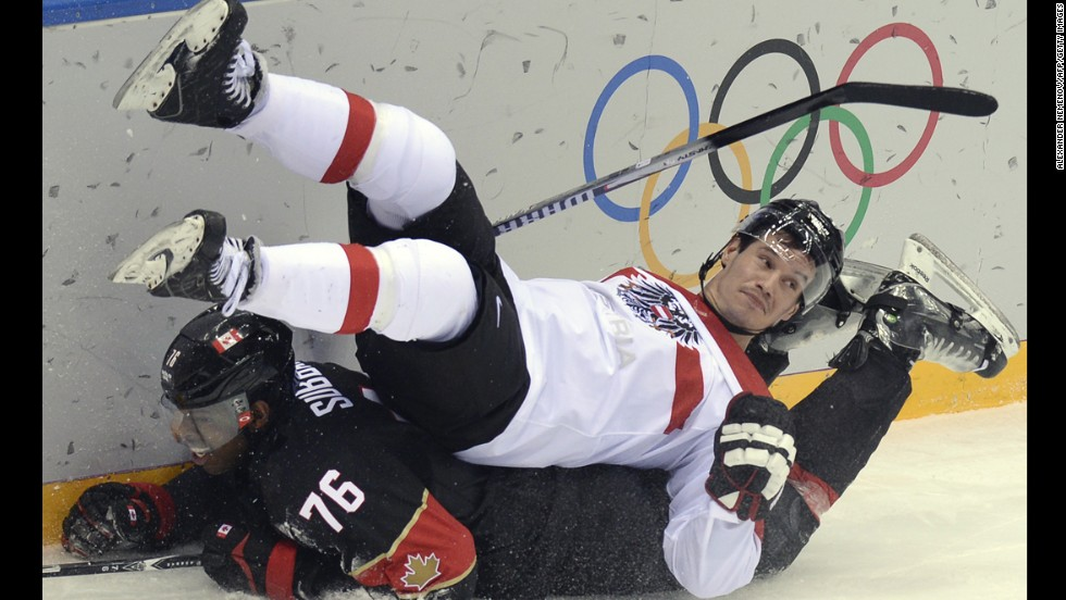Canada's P.K. Subban, bottom, collides with Austria's Oliver Setzinger during the men's ice hockey game on February 14.