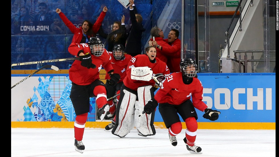 Switzerland celebrates winning 2-0 against Russia in the women's ice hockey quarterfinals.