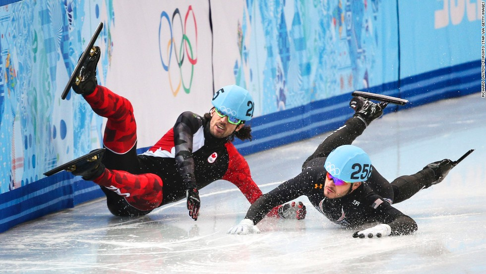 Canada's Charles Hamelin crashes, taking out American Eduardo Alvarez during the quarterfinals of the 1,000-meter short track speedskating event.
