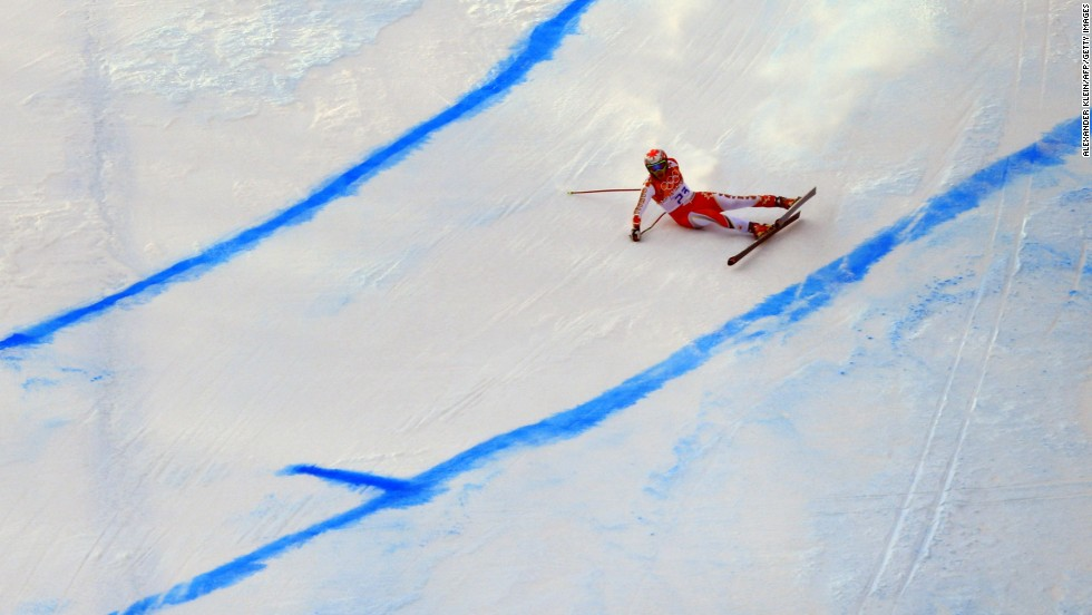 Canada's Erik Guay falls during the men's super-G.