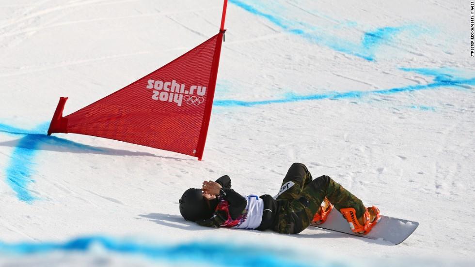Yuka Fujimori of Japan falls during the women's snowboard cross on February 16.