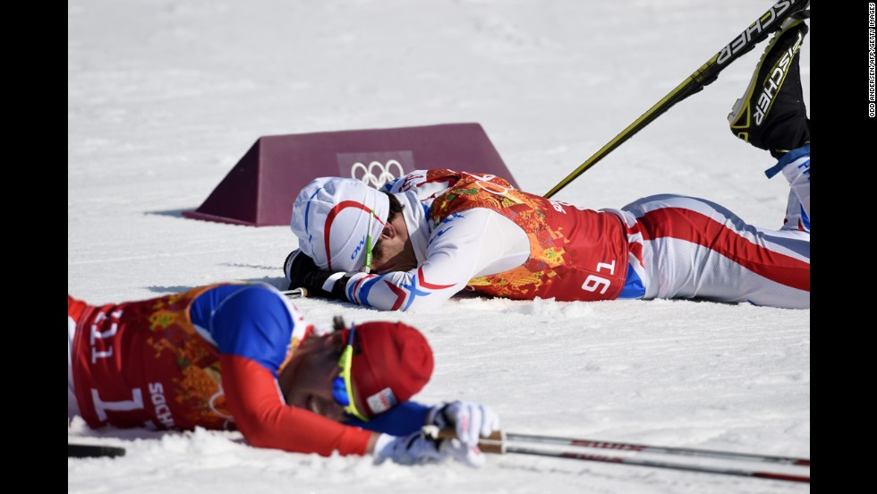 The Czech Republic's Ales Razym, left, and France's Jean Marc Gaillard rest after competing in the first group of the men's cross-country relay on February 16.