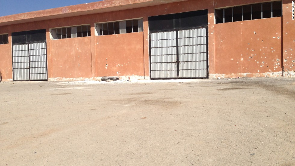This warehouse was used as a jail to hold and execute prisoners.  A mass grave was found behind it, and bullet holes mark its walls.