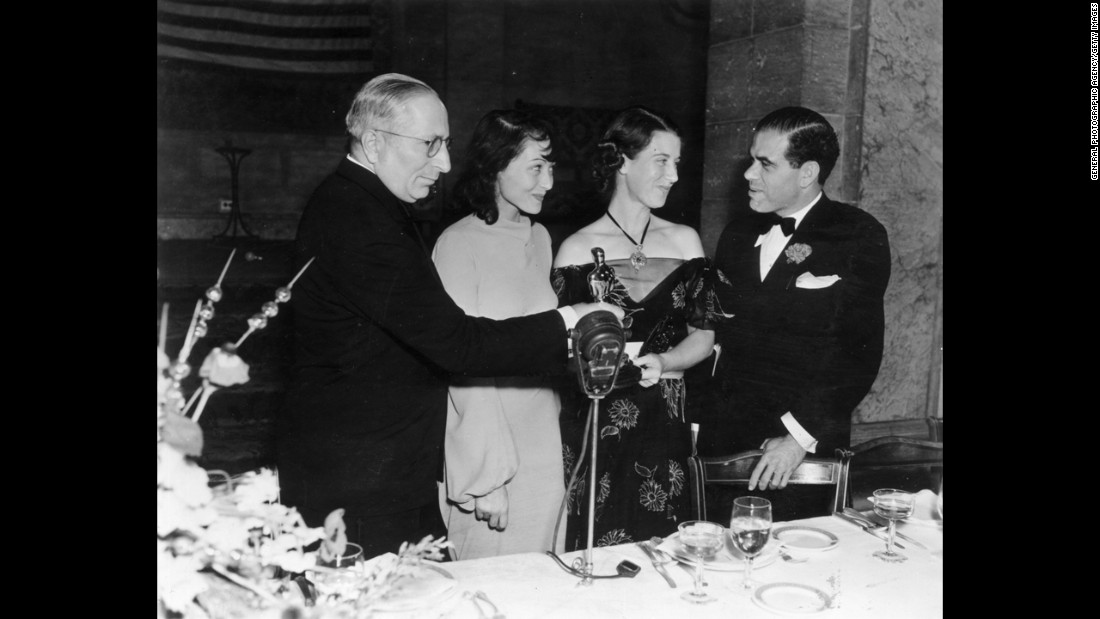"Luise Rainer, second from left, is seen at the 1937 ceremony with, from left, Louis B. Mayer, Louise Tracy and Frank Capra. Rainer won for ""The Great Ziegfeld."""