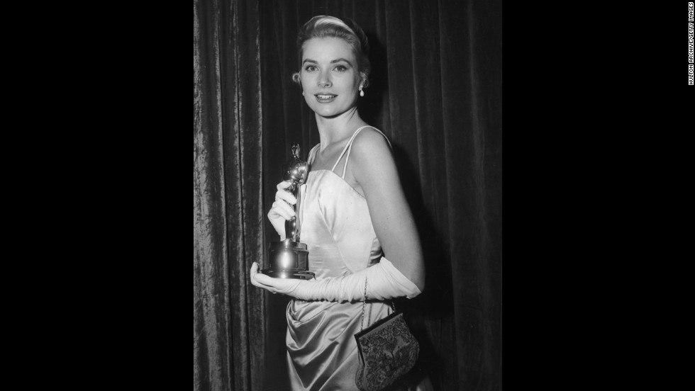 "Grace Kelly poses with her Oscar after the Academy Awards ceremony in 1955. She won the statuette for her role in ""The Country Girl."""