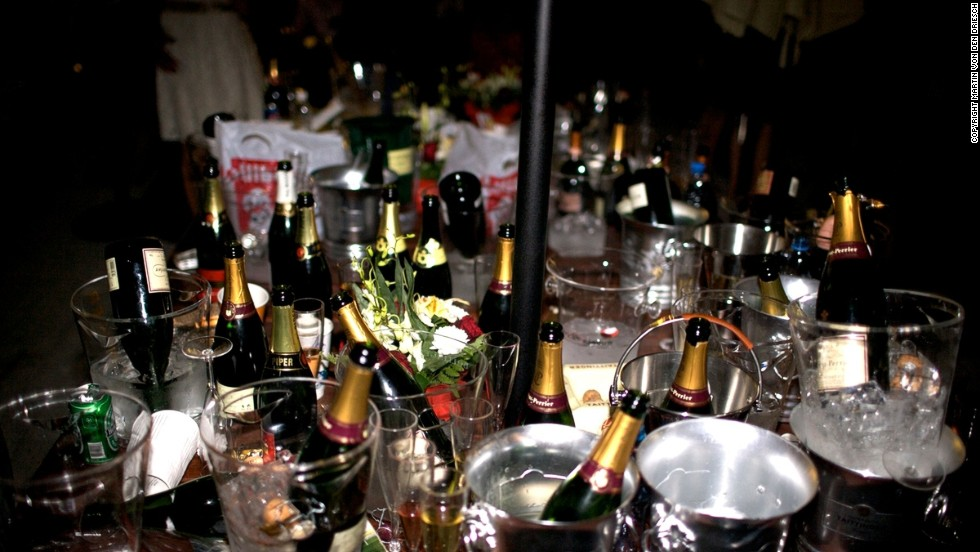 Champagne bottles, ice buckets and a rogue can of lager lie strewn across a table in the Bubble Lounge.