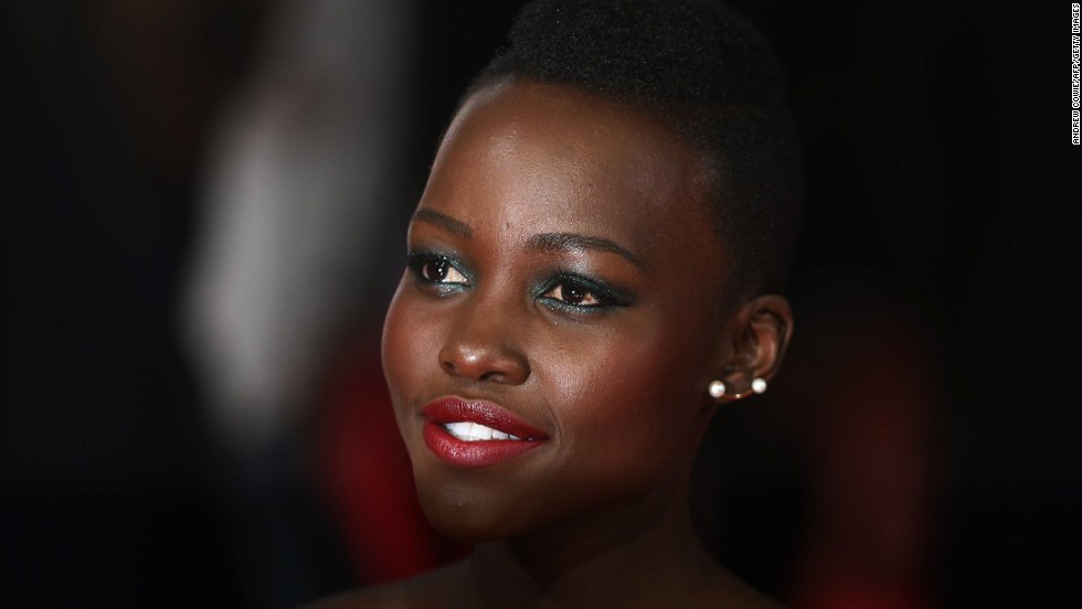 "FEBRUARY 17 - LONDON, UNITED KINGDOM: Kenyan actress<a href=""http://cnn.com/2014/02/14/showbiz/1-to-1-lupita-nyongo-life-journey/""> Lupita Nyong'o</a> arrives on the red carpet for the British Academy Film Awards (BAFTA) at the Royal Opera House on February 16. <a href=""http://cnn.com/2014/02/14/showbiz/1-to-1-lupita-nyongo-life-journey/"">The 3D space disaster movie ""Gravity"" and the drama ""12 Years a Slave,"" </a>in which Nyong'o performed a supporting role, scooped the awards."