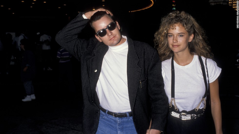 """Before she married John Travolta, actress Kelly Preston was the main squeeze of Charlie Sheen. In 1990 Preston was injured when a gun discharged in the couple's home and the pair soon ended their engagement.<a href=""""http://www.eonline.com/news/239915/did-charlie-sheen-really-shoot-kelly-preston-21-years-later-we-get-the-answer"""" target=""""_blank""""> In 2011, Sheen went on record</a> to say he didn't shoot Preston, but that his revolver accidentally went off after it fell out of a pair of his pants she picked up in the bathroom."""