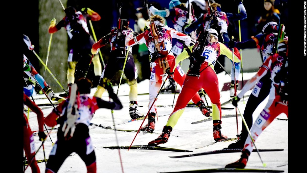 Biathletes compete in the women's 12.5-kilometer mass start event on February 17.