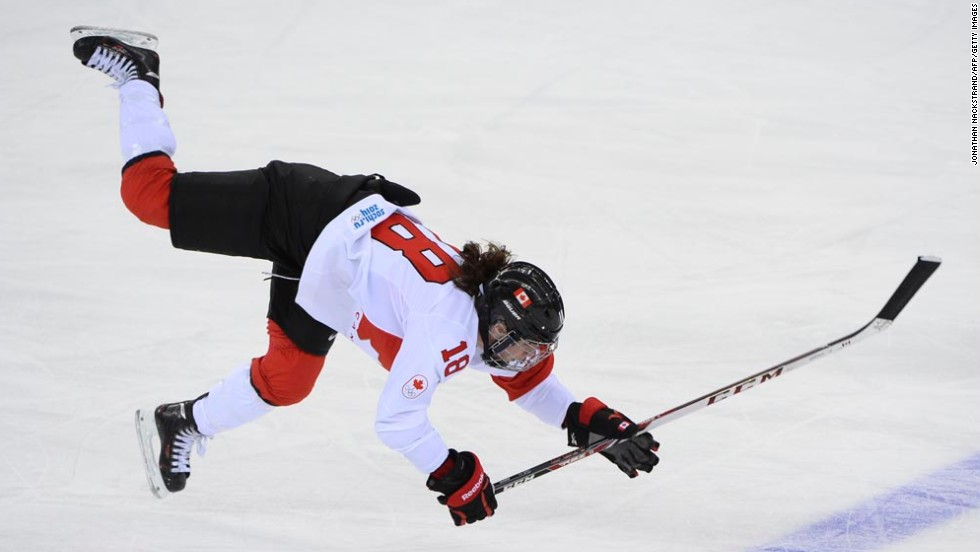 Canadian hockey player Catherine Ward falls after she was hit in the Olympic semifinal against Switzerland on Monday, February 17.