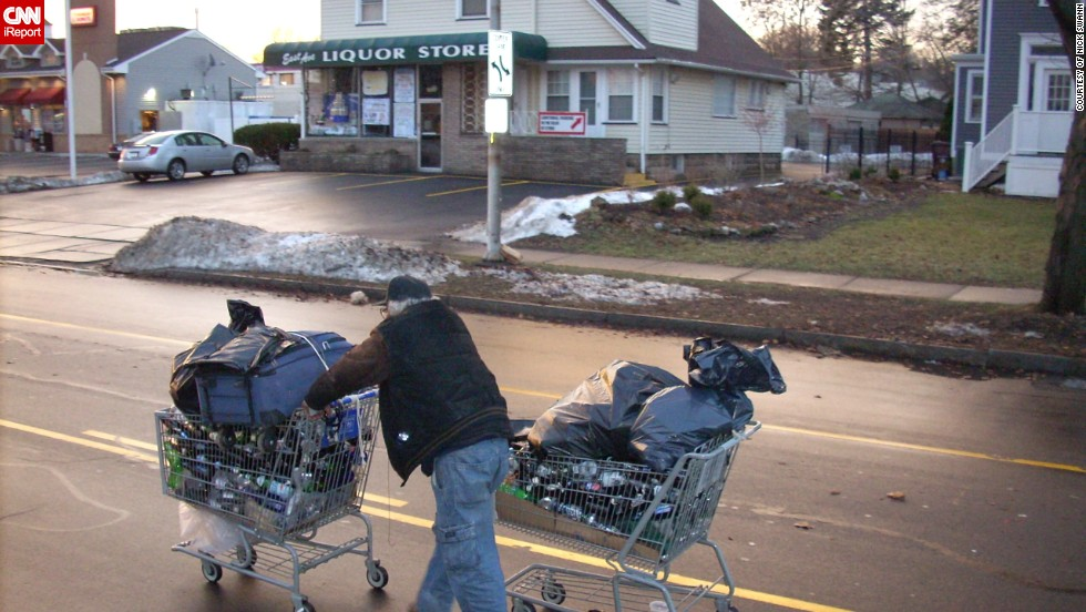"<a href=""http://ireport.cnn.com/docs/DOC-1080121"">Nick Swann</a> photographed this man carting around bottles and cans. ""I have seen these guys wandering around at all hours of the day in single-digit temperatures,"" Swann said.  ""Just wandering from Dumpster to Dumpster, garbage can to garbage can, looking for a can or bottle."""