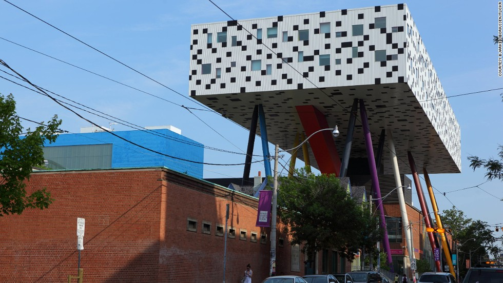 At Toronto's OCAD University, the Sharp Centre for Design is perched 26 meters above the ground on 12 stilts representing giant pencils. Five legs out of the six multi-colored pairs are painted black to give an illusion of slenderness, especially at night when the black legs seem to disappear. <strong>Architects:</strong> Alsop Architects, Robbie/Young + Wright Architects.