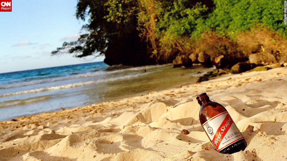 """Have a beverage with your beach. <a href=""""http://ireport.cnn.com/docs/DOC-1082773"""">Rick Lindo</a> grew up in Jamaica and visits often. """"I try to take my family to different parts of the island so they can get the full experience of Jamaica and realize it's not just a tourist destination."""""""