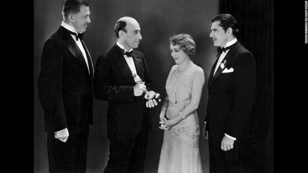 "Warner Baxter, right, earned the best actor Oscar for his role as the Cisco Kid in ""In Old Arizona"" (1929). Baxter appears here with best actress winner Mary Pickford at the April 1930 awards ceremony, which recognized films made between August 1, 1928, and July 31, 1929. Baxter loved the role so much he reprised it twice more, in ""The Cisco Kid"" (1931) and again in ""The Return of the Cisco Kid"" (1939)."