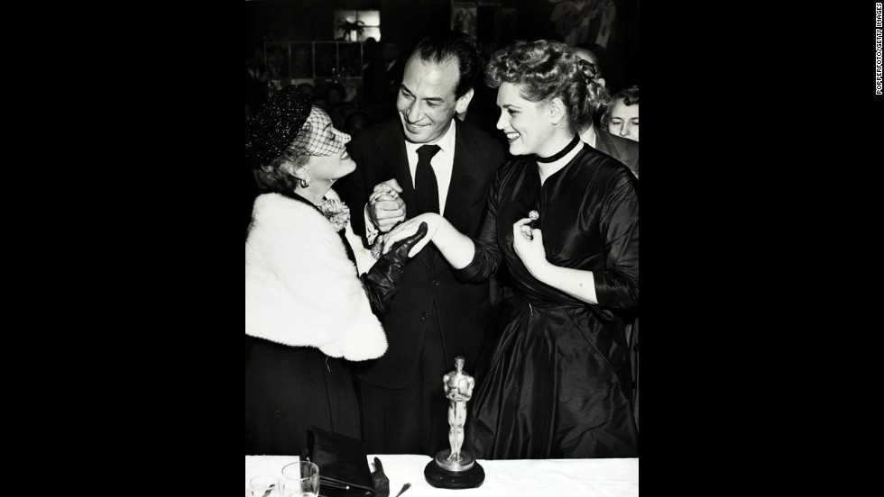 "Puerto Rican-born José Ferrer became the first Hispanic to win an Oscar when he was named best actor for ""Cyrano de Bergerac."" Here he appears with Gloria Swanson, left, and Judy Holliday (best actress for ""Born Yesterday"") in 1951."