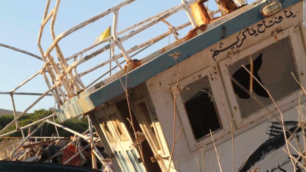 Abandoned boats fill a ship graveyard off the harbor.