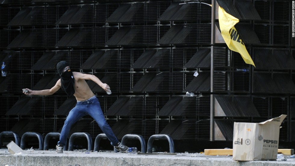 A protester throws a stone in Caracas on February 12.