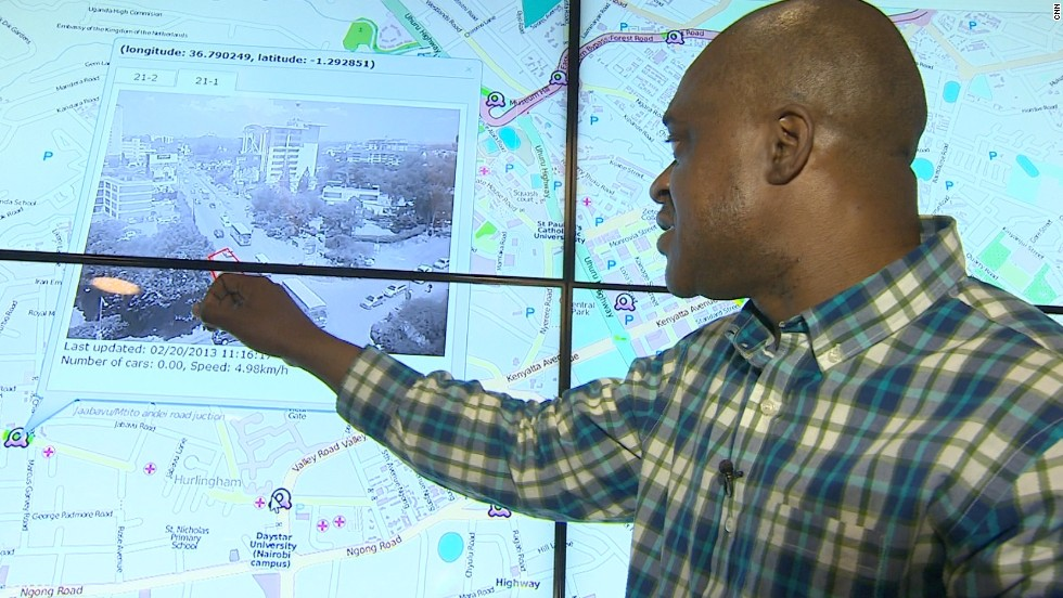 Stewart showcases one of IBM Research Africa's latest innovations on touchscreen displays. He is currently analyzing traffic data from Nairobi to determine what infrastructure needs to be implemented to ease transport gridlock on the capital's roads.