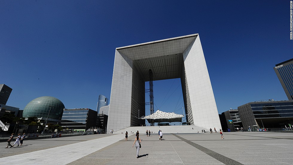 "<em>La Grande Arche de la Défense</em><br /><br />In 1982 French president François Mitterrand staged an international design competition to create a ""modern Arc de Triomphe"". The Danish duo of Johann Otto von Spreckelsen and Erik Reitzel won with their Grande Arche de la Défense, which is meant to celebrate humanity rather than commemorate military conquest. Visitors don't just get a view of Paris through the Arc: there is also a viewing platform on its roof."
