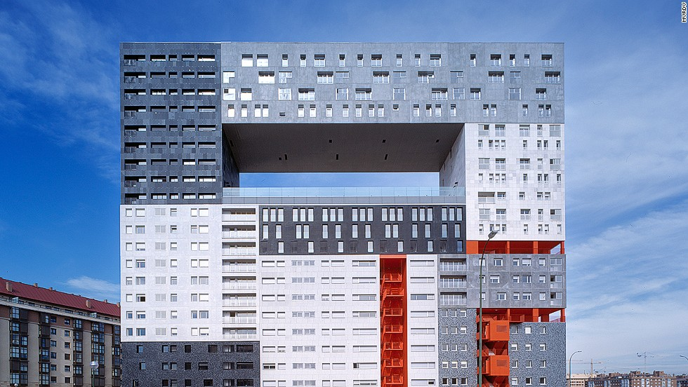 "<em>The Mirador, Madrid</em><br /><br />Architectural firm MVRDV did not run out of money before completing <a href=""http://www.mvrdv.nl/projects/mirador/"" target=""_blank"">The Mirador</a> apartment complex in Madrid. The hole in the middle is actually a semi-public sky plaza which provides an ideal vantage point to enjoy the nearby Guadarrama Mountains. It also includes a community garden, thereby ""monumentalizing public life and space."""