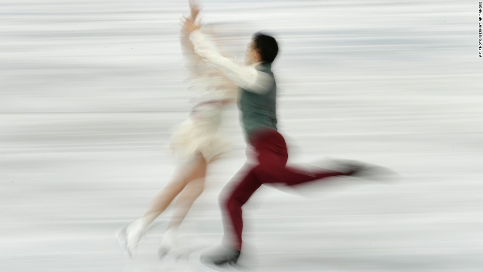 "FEBRUARY 18 - SOCHI, RUSSIA: Anna Cappellini and Luca Lanotte of Italy compete in the figure skating ice dance finals at the Iceberg Skating Palace on February 17. Highlights at the Winter Games today include men's ice hockey, as Russia must win its playoff match against Norway or face an embarrassing early exit. <a href=""http://olympics.edition.cnn.com/Event/Sochi_2014_LIVE?hpt=isp_c1"">Follow all the live action here.</a>"
