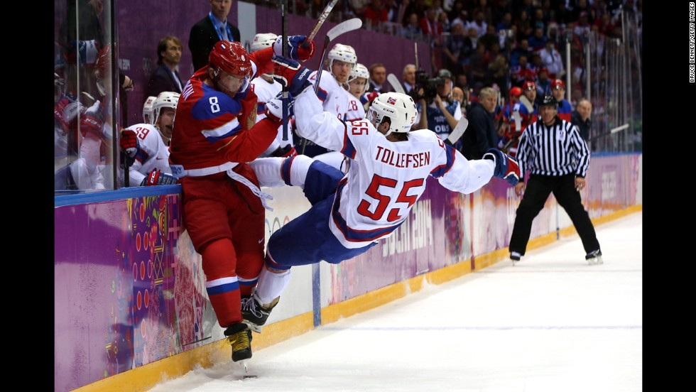 Alexander Ovechkin of Russia checks Ole-Kristian Tollefsen of Norway during the men's hockey game February 18.